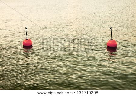 Red bouy on a calm lake - toned image