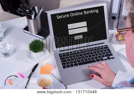 woman working on computer with secure online banking