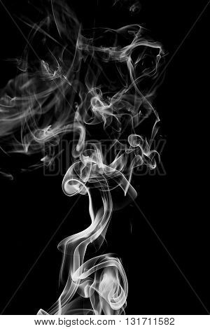 Abstract white on black background from the incense sticks