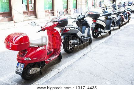 Trieste Italy - April 22 2016 : Motorbike motorcycle scooters parked in row in city street.
