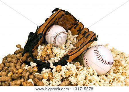 Baseball season concept with baseball mitt and baseball resting on peanuts and popcorn on white background.