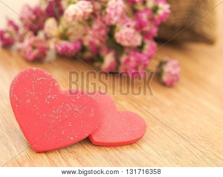 Valentines day background with red hearts on wood floor. Love and Valentine concept.