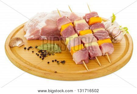 Raw pork, slices of meat and vegetables on skewers, spice isolated on white background.