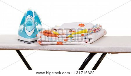 Steam iron, ironing board and bed linen isolated on white background.
