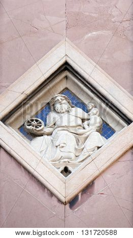 FLORENCE, ITALY - JUNE 05: Saturn by Collaborator of Andrea Pisano, Relief on Giotto Campanile of Cattedrale di Santa Maria del Fiore (Cathedral of Saint Mary of the Flower), Florence, June 05, 2015