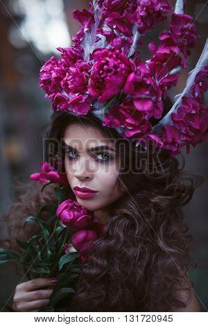 Beautiful Woman With Crown Holding Purple Peonies
