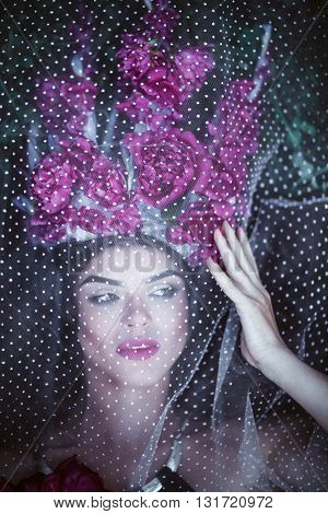 Beautiful Woman With Crown Lying Under Tulle