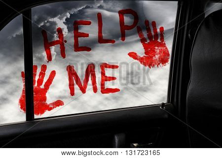 Red handprints and the inscription on the glass door of the car on the night sky