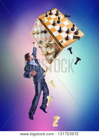 Businessman with chess set