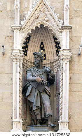 FLORENCE, ITALY - JUNE 05: Saint Luke by Giambologna Orsanmichele Church in Florence, Tuscany, Italy, on June 05, 2015