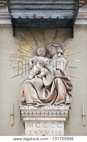 BOLOGNA, ITALY - JUNE 04: Virgin Nary with baby Jesus statue on house facade in Bologna, Italy, on June 04, 2015