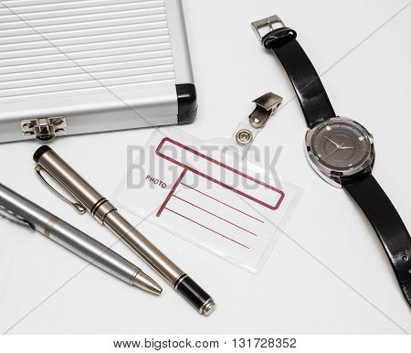 office tools blank notepad with pen glasses and badge security