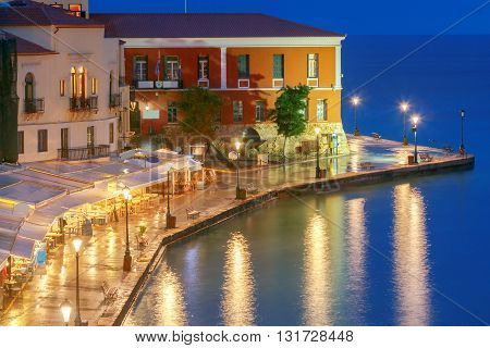 Night view of the quay with lanterns and the old harbor in Chania. Greece.