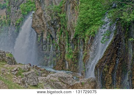 Kapuzbashi Waterfalls surrounded with bright green foliage. Turkey Aladaglar Mountains.