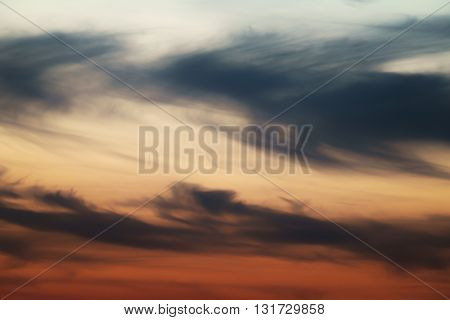 dask sunset sky with clouds, orange color