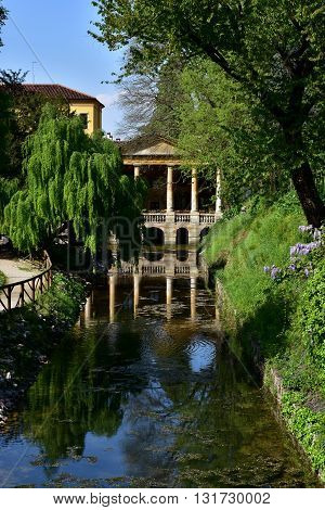 Giardini Salvi public park in the center of Vicenza with renaissance Loggia Valmanara and ancient Roggia Seriola moat