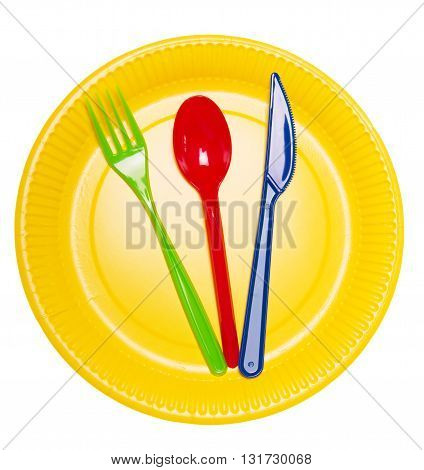 Set bright disposable dishes: a plate, spoon, fork and knife isolated on white background.