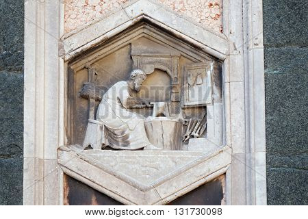 FLORENCE, ITALY - JUNE 05: Tubalcain by Nino Pisano, 1334-36., Relief on Giotto Campanile of Cattedrale di Santa Maria del Fiore (Cathedral of Saint Mary of the Flower), Florence, on June 05, 2015