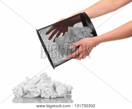 In the hands of a waste basket with paper waste isolated on white background.