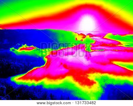 Infrared Scan Of Rocky Landscape, Pine Forest With Colorful Fog, Hot Sunny Sky Above. Amazing Thermo