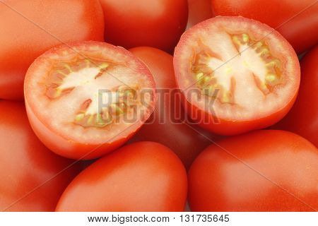 fresh and colorful italian roma tomatoes background