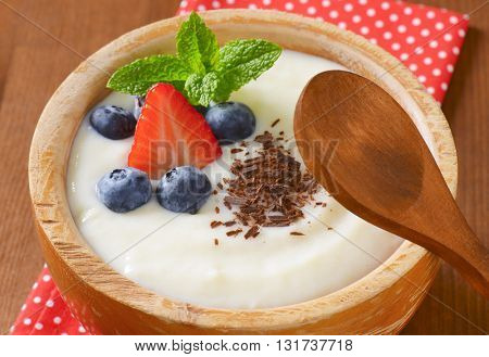 bowl of semolina pudding with fresh fruit - detail