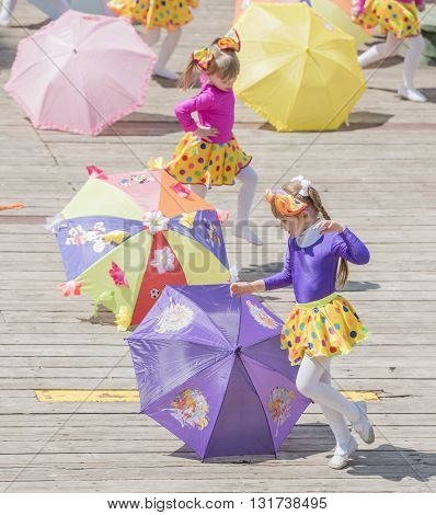 Rostov-on-Don Russia- May 22, 2016: Dance of the girls with colored umbrellas at the carnival