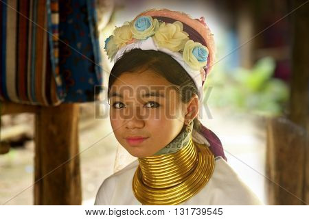 Ayutthaya, Thailand - September 13, 2015:  Padaung girl with traditional dress poses for a portrait in Ayutthaya, Thailand