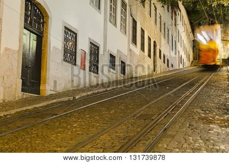 Famous yellow tramway in Lisbon, night view
