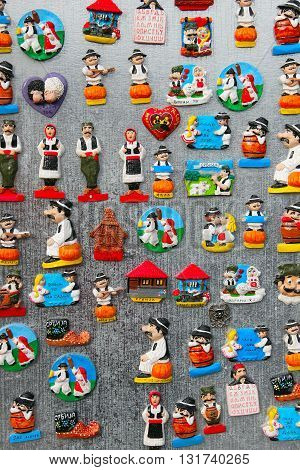 Novi Sad, Serbia, May 2016, Fridge magnet souvenirs representing Serbian national culture and costumes