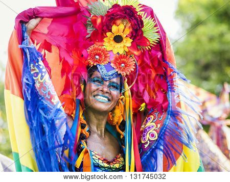 Rio de Janeiro, Brazil - February 9, 2016: Beautiful Brazilian woman of African descent wearing colourful costume and smiling during Rio Carnaval 2016 street parade, Rio de Janeiro Brazil.