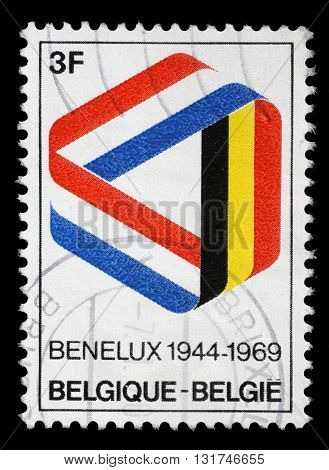 ZAGREB, CROATIA - JULY 03: a stamp printed in the Belgium shows Mobius Strip in Benelux Colors, 25th Anniversary of the Signing of the Customs Union, circa 1969, on July 03, 2014, Zagreb, Croatia