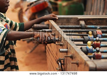 MOPTI, MALI - AUGUST - 26 - 2011: African children playing foosball table