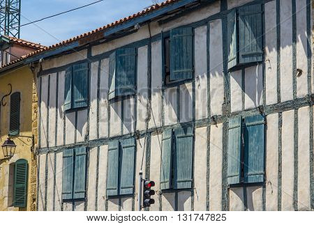 Typical buildings of Basque country in a street of Bayonne. Aquitaine France.