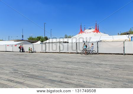 Zurich, Switzerland - 26 May, 2016: people at the fence of Circus Knie temporarily installed on Sechselautenplatz square. Circus Knie is the largest circus of Switzerland based in Rapperswil founded in 1803 by the Knie family.