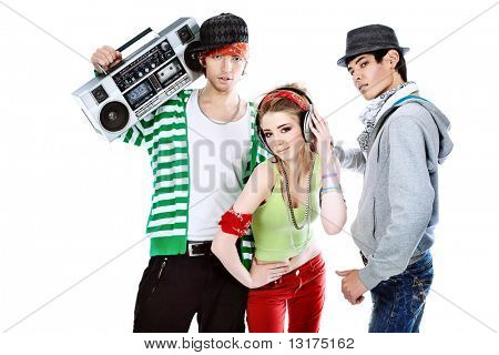 Group of trendy teenagers dancing together. Isolated over white background.