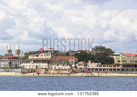 People On The Beach Of Stone Town