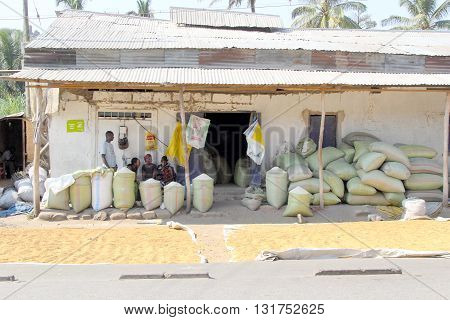 Bags Of Maize And Rice Outside A Local Store