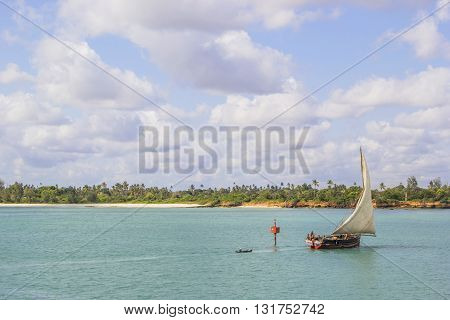 ZANZIBAR TANZANIA - JUNE 16: ship sailing along the coast on June 16 2013 in Zanzibar