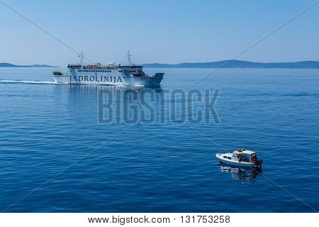 Split Croatia - May 07 2016: Jadrolinija Ancona to Spli ferry passing a small boat