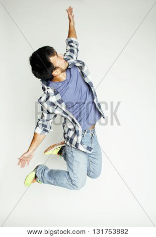 young pretty asian man jumping cheerful against white background, lifestyle people concept, man flying