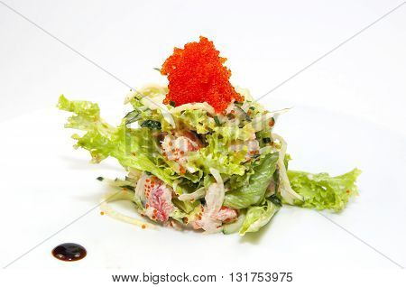 salad greens and seafood on a white background