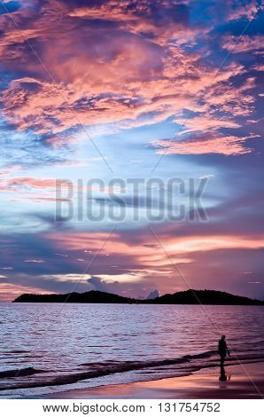 Sunset at Lammaepim Beach with a colorful twilight sky Rayong Thailand.