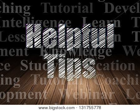 Education concept: Glowing text Helpful Tips in grunge dark room with Wooden Floor, black background with  Tag Cloud