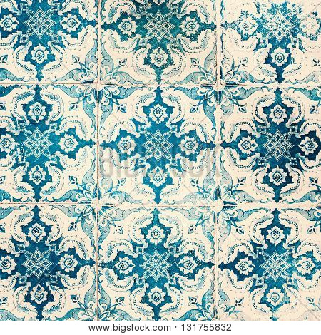 Old worn texture. Traditional ornate portuguese decorative tiles azulejos. Vintage pattern. Wall Azulejo ornaments.