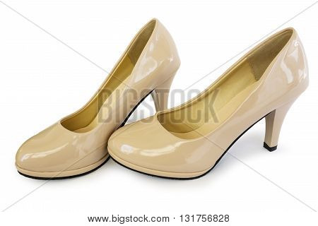 Elegant shoes of beige color on white background