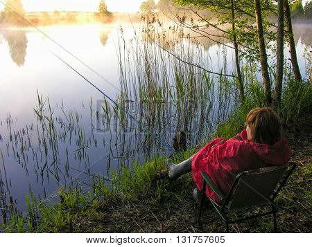 Dawn of fishing on the beautiful forest lake