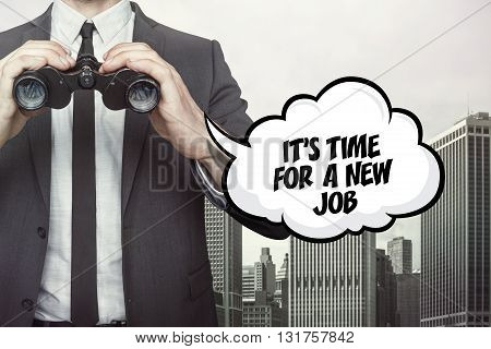 Its time for a new job text on speech bubble with businessman holding binoculars on city background