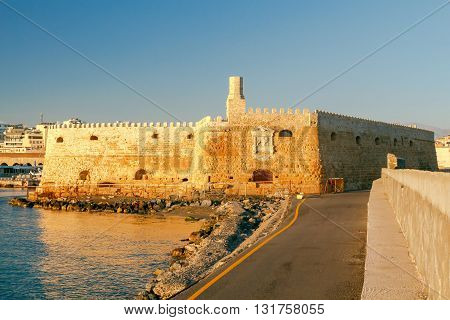 A view of the Venetian Fortress and the Greek flag over her early in the morning. Crete.