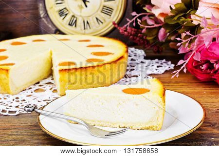 Cheesecake with Apricots on Plate. Studio Photo